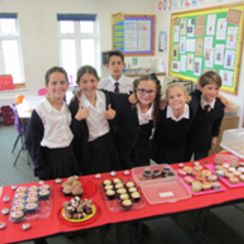 Will and his team raise money with a cake sale