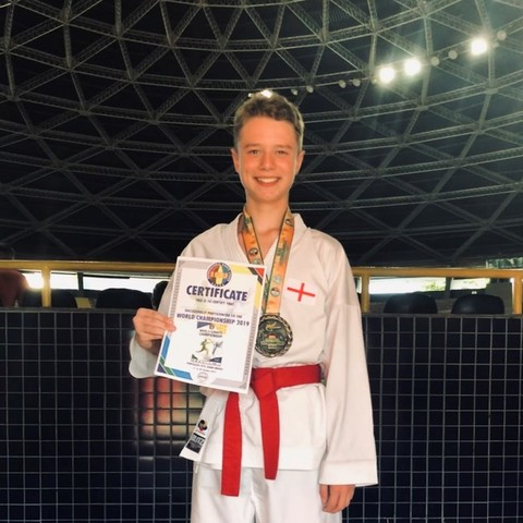William at the IKU World Karate Championships with his bronze medal