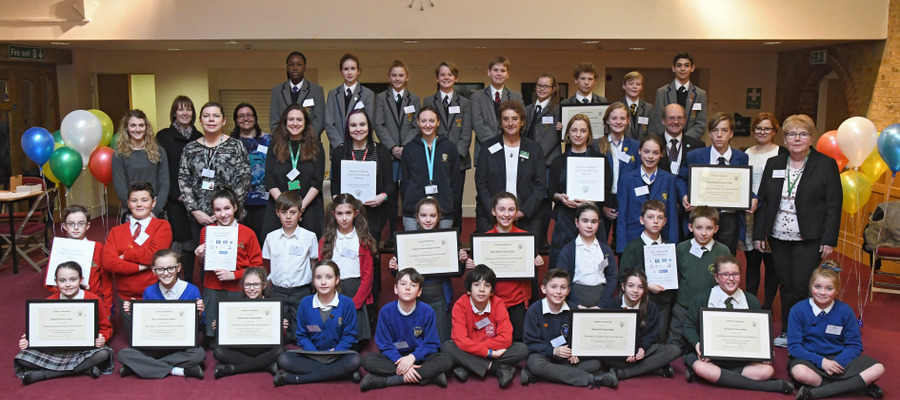 Group photo of the participating schools and their certificates