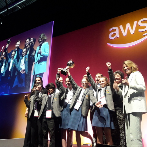 The 5 Prep School pupils on stage with their trophy