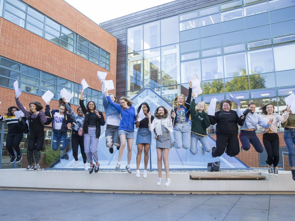 GCSE students jumping from pyramid