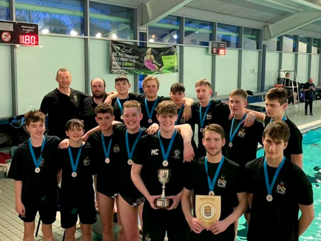 The victorious Bolton School Boys' Division Under 18 Water Polo team with their ESSA National Finals trophies