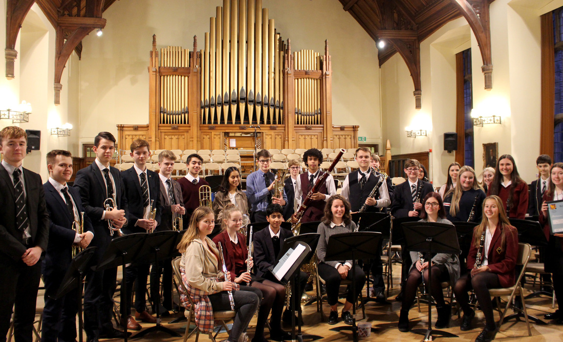 The Bolton School Joint Concert Band with their award
