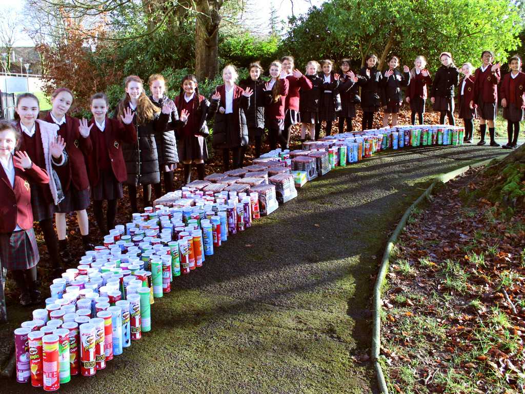 Junior Girls' School pupils with their impressive donation of Pringles tubes