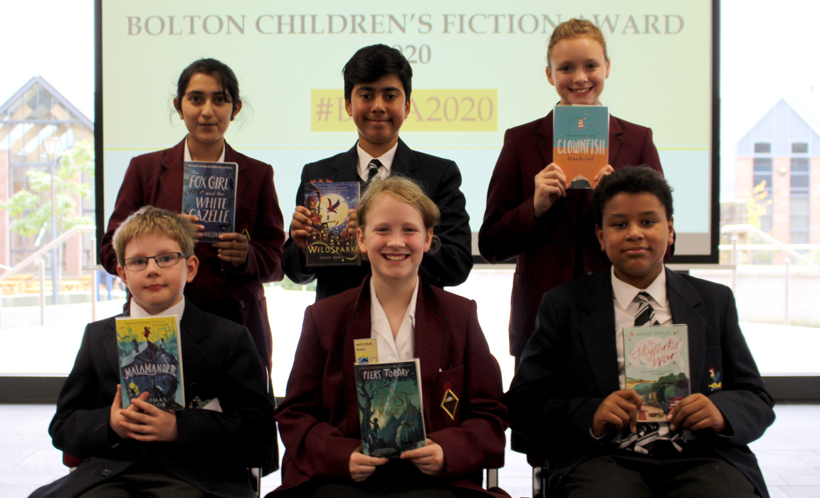 Bolton School pupils with copies of the six books shortlisted for the Bolton Children's Fiction Award 2020