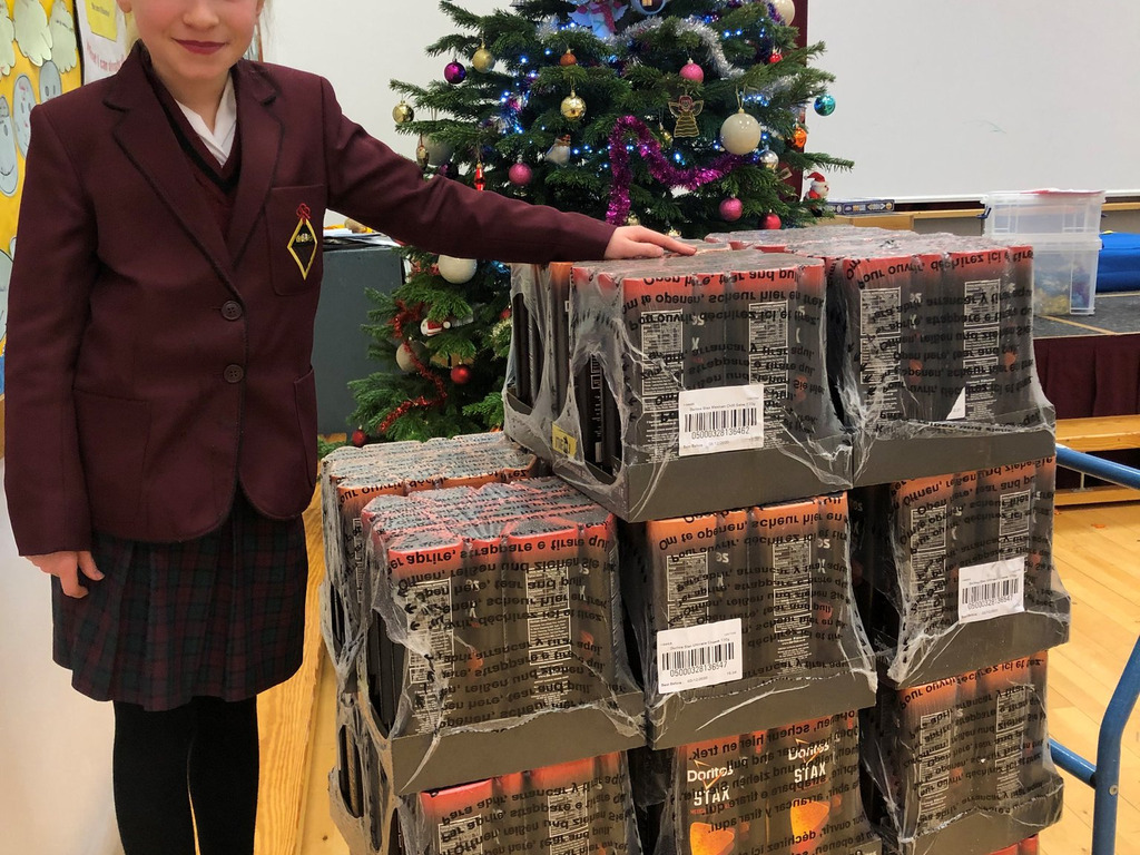 Year 3 pupil Izzy with the Doritos Stax her family donated