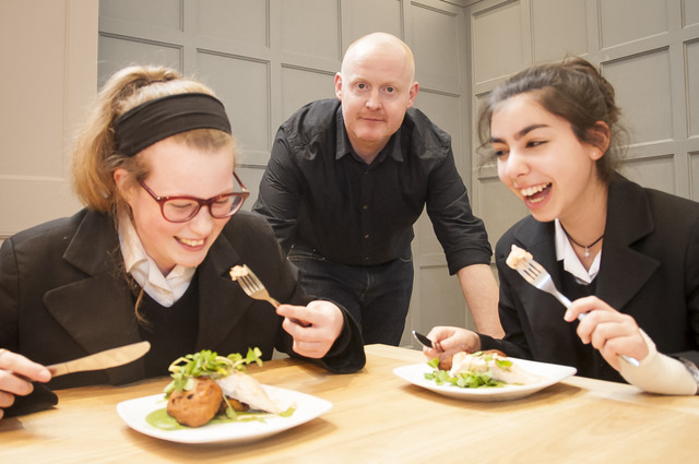 Pupils tuck into chef Ben McKellar's salmon and sweet potato cakes