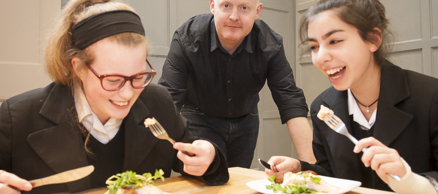 Pupils tuck into chef Ben McKellar's salmon and sweet potato cakes