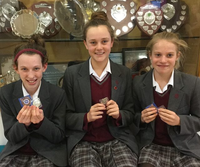 Lilly-Marie Derry, Evelyn Davis, and Annabel Smith with their medals