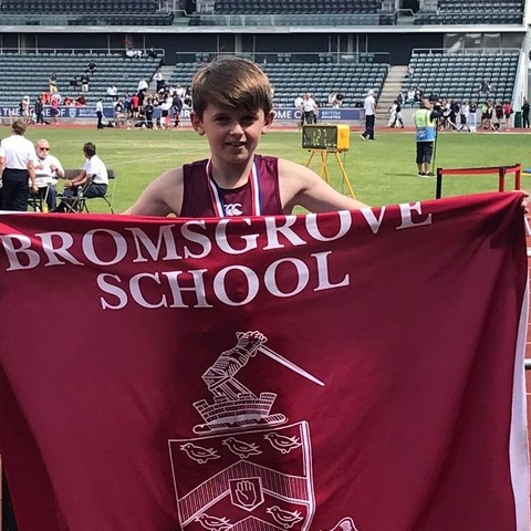 Oliver D with flag National Prep School Championships