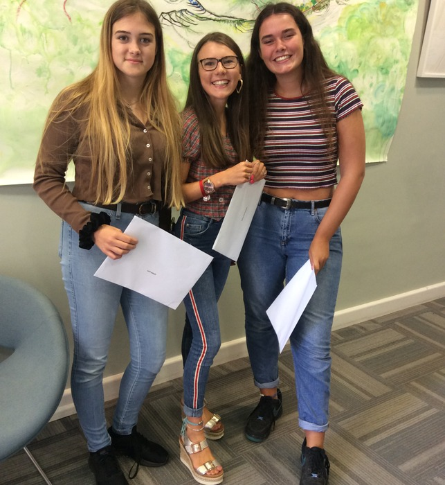 Delighted Upper Sixth students Lucy, Millie and Charlotte celebrate their A level results at Bruton School for Girls.