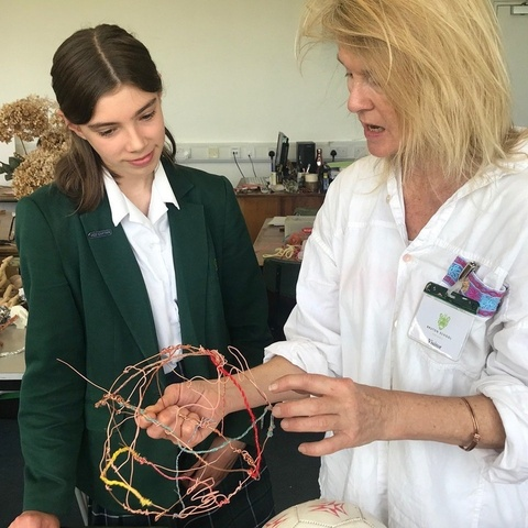 Artist Fiona Campbell at work with one of the pupils from Bruton School for Girls