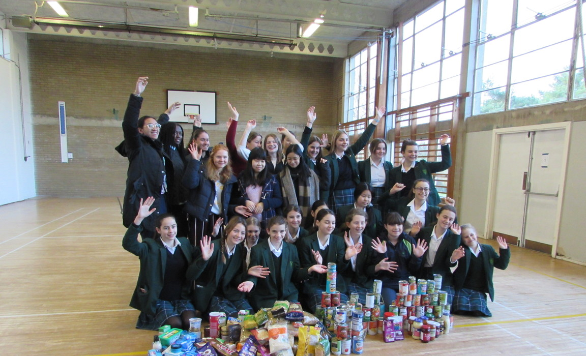 Girls from Montacute Hall at Bruton School for Girls with some of the items collected for the local food bank.