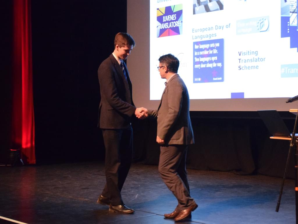 Oliver receiving his award