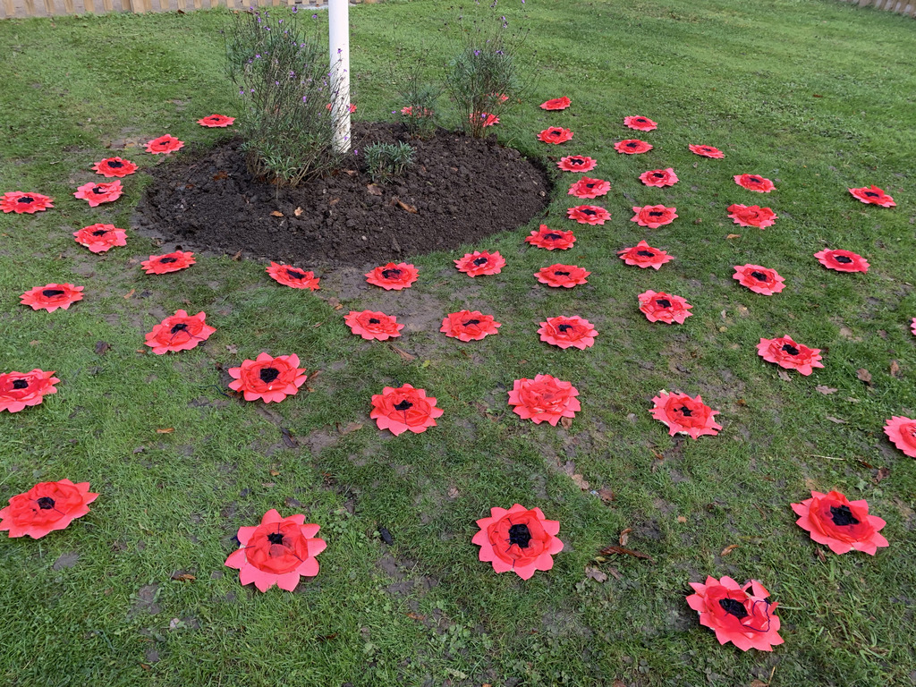 Homemade poppies surrounded the school's flagpole