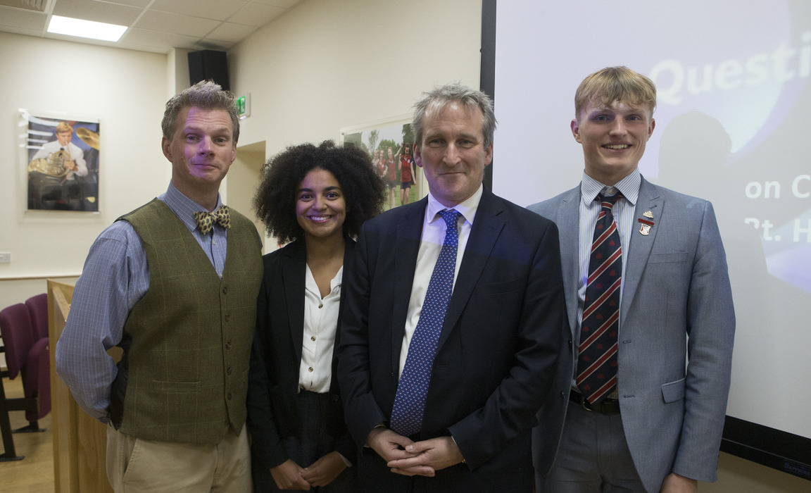 Damian Hinds with teacher John Lofthouse (far left) and students Eva Ihezue (second left) and Jude Franklin (right)
