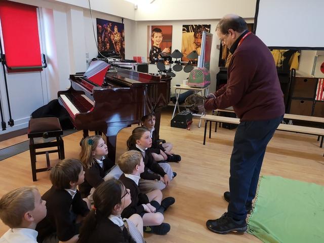 Graham Bowring Shows Pupils Rescued Hedgehog