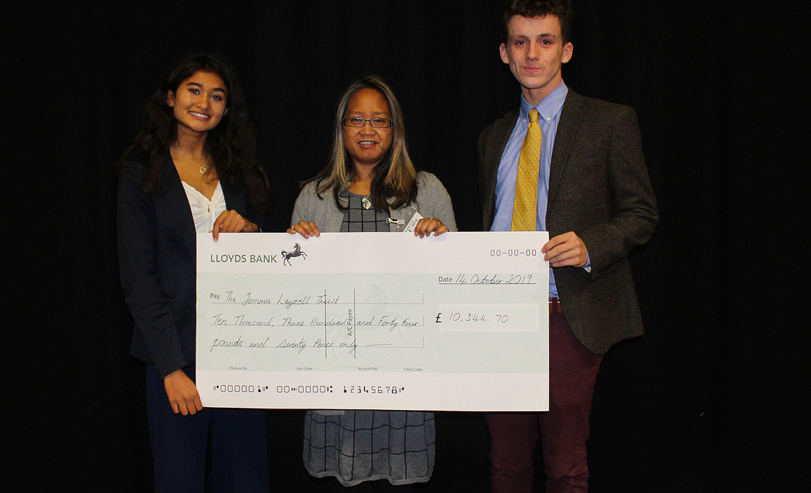 Pupils from Dauntseys's present a cheque to the Jemima Layzell Trust