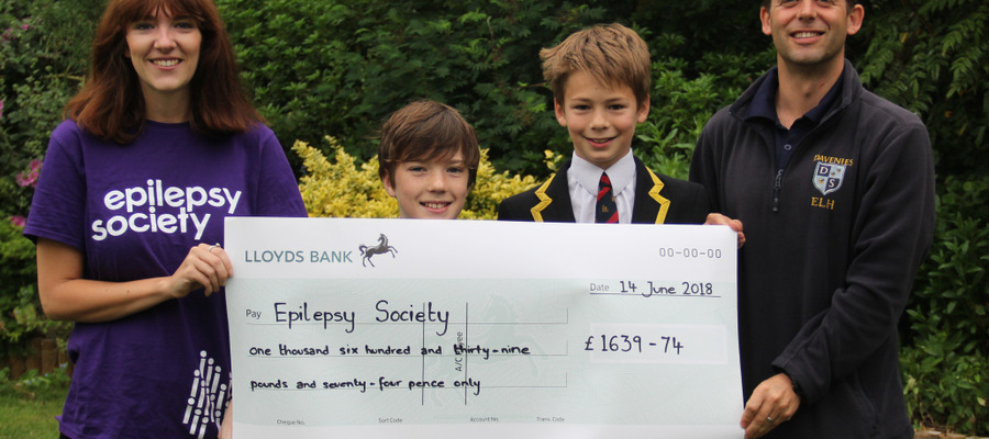 The boys of Shackleton House presenting a cheque to Epilepsy Society