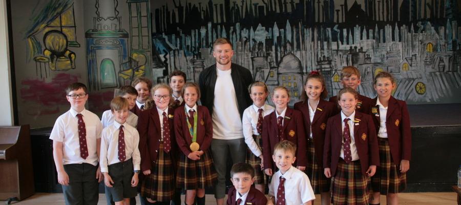 Adam Peaty with children from Denstone College Prep School