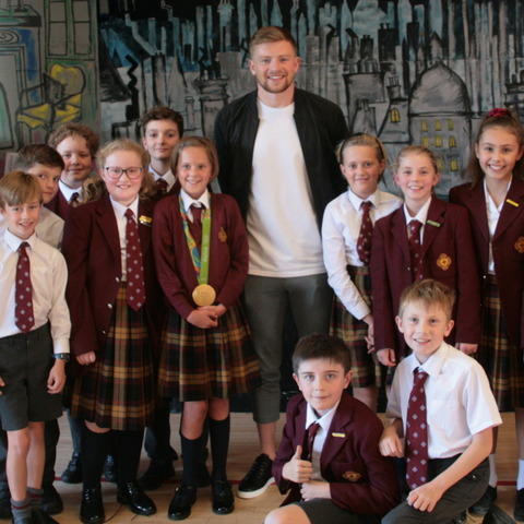 Adam Peaty with children from Denstone College Prep School
