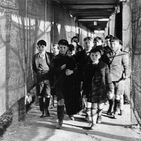Dulwich Prep 1939 boys walk to lessons in huts
