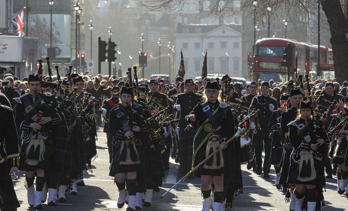Bringing Whitehall to a standstill, the Gordon's School students led by their Pipes and Drums. The school makes an annual parade to the statue of Gene