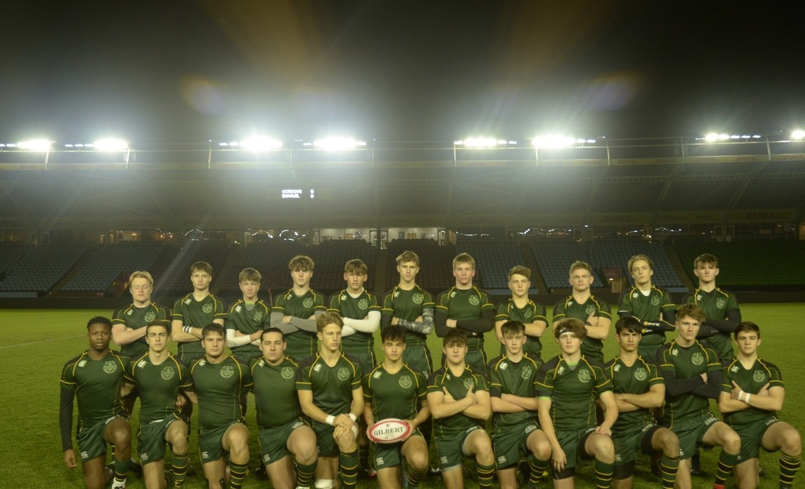 The squad under the bright lights of the home of the Harlequins - the Stoop in Twickenham.