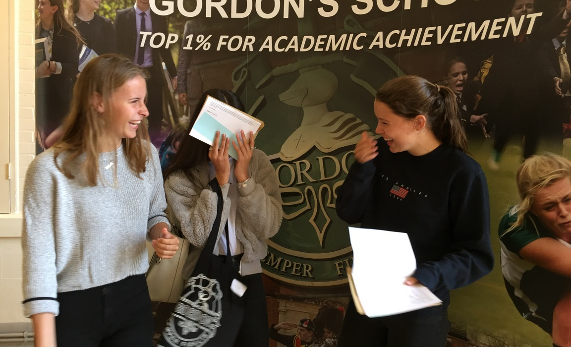 Delighted A Level students at Gordon's School celebrate another excellent set of results.