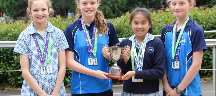 Tilly, Juliet, Pearl and Venetia with their trophy