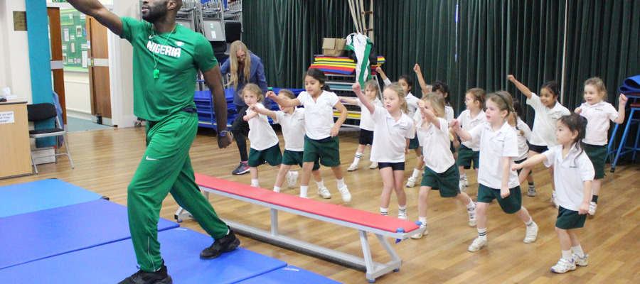 Long jumper Ezekiel leads the girls in a sponsored challenge