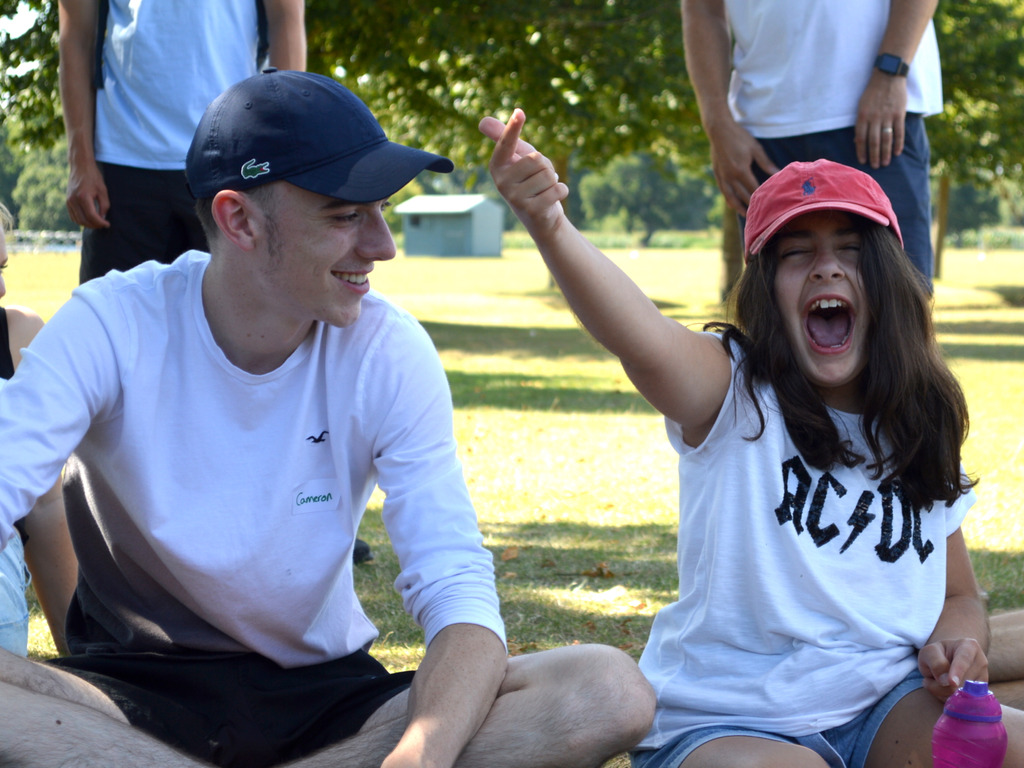 Volunteer and child at Highfield Highreach Holidays 2020