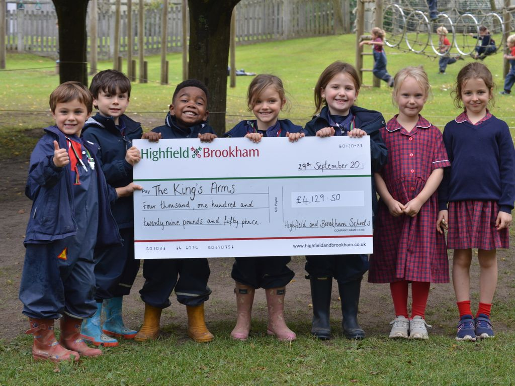 Highfield and Brookham children present cheque to The King's Arms charity