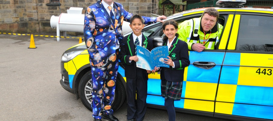 Head of Highfield Mr James Savile, Head Boy Nico Granillo, Deputy Head Girl Selin Gul and PC Rob Jessiman MOD Police