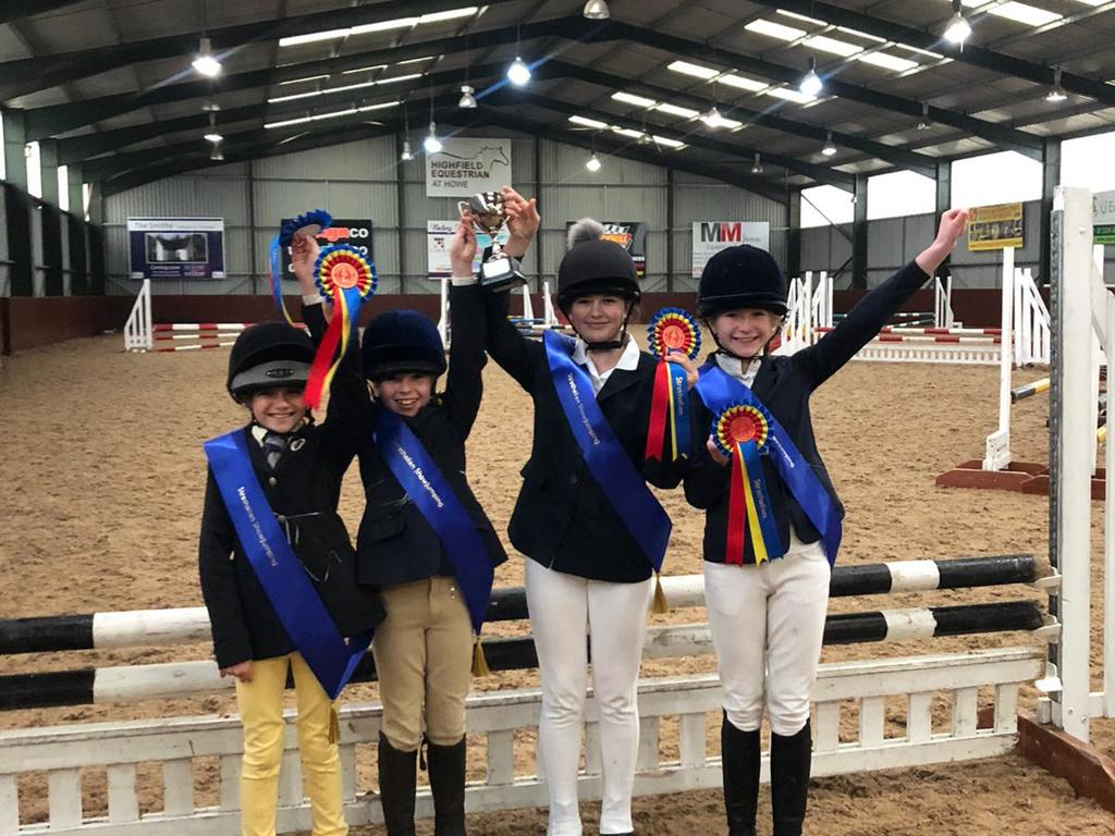 Kilgraston School pupils celebrating their success at the Strathallan School's showjumping competition where the teams won three out of the four class