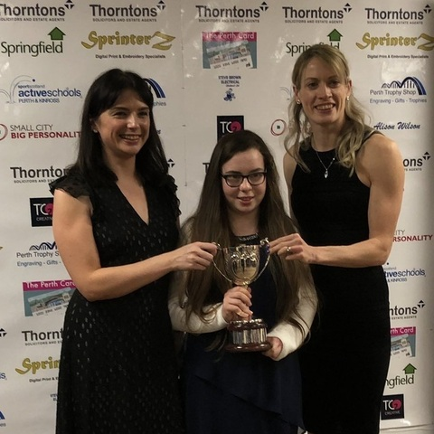Kilgraston pupil Freya Howgate receiving her Disability Sports Person of the Year at the Perth and Kinross 2018 Sports Awards from top Scottish athlet
