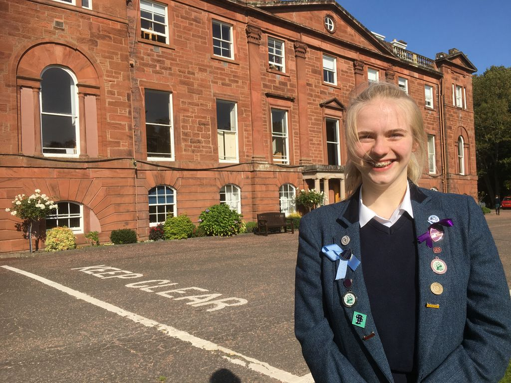 Anna outside Kilgraston School having heard about her Foyle Young Poet Award