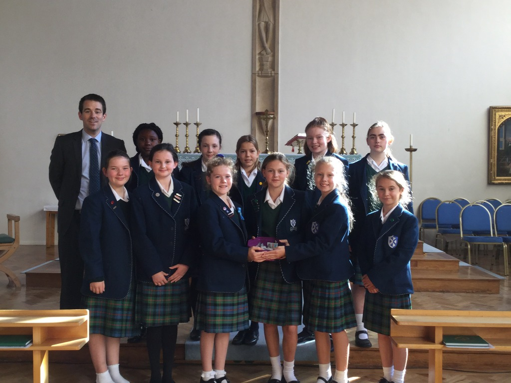 Pupils from Kilgraston's Junior Years in the School Chapel with Head of Religious Education at the School, Stephen Johnston
