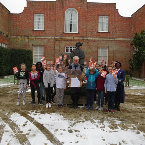 Dr The with Year 7 pupils holding the author's latest book Coyote Summer