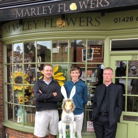 photo taken outside Harvey's mother's flower shop, shows HAREcules,  CFA's Lawyer Group member, Christian Parker with Harvey King & Rev David Standen.