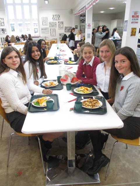 KEHS girls enjoying a 1918-style 'street party' with recipes taken from the wartime cookbook of the school's influential cookery mistress Miss Florenc