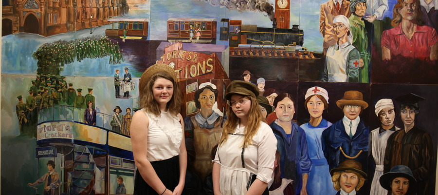KEHS students admiring the commemorative mural during the Armistice Centenary celebration