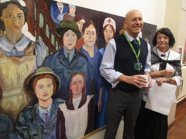 KEHS Head of Art Nick Bassett and Cas Britton, Armistice Centenary COmmemoration organiser beside the World War I mural
