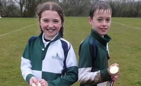 Olivia and Bertie celebrating their cross country success