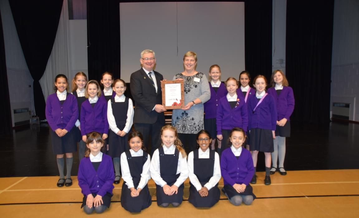 Receiving Certificate of Appreciation from the Royal British Legion