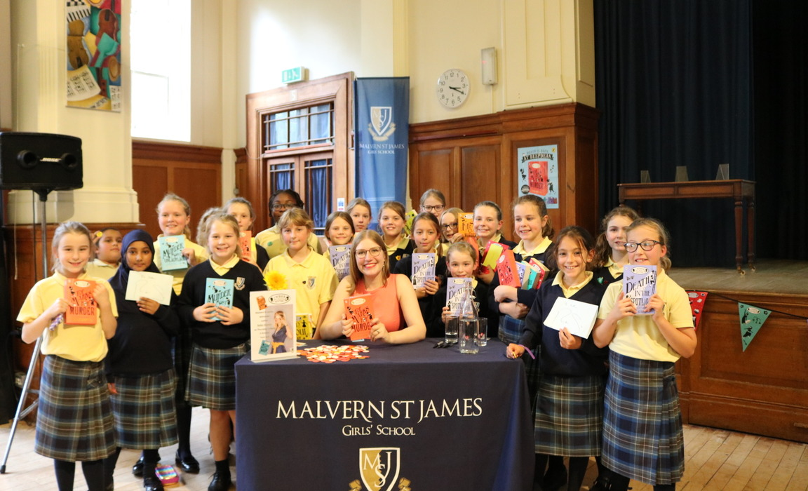 Year 5 and 6 girls from MSJ with Robin after having their books signed by the author