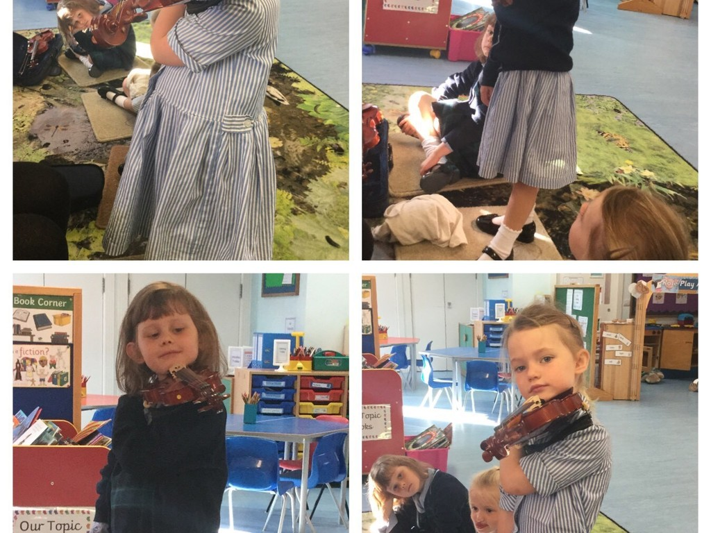 Reception Girls Learning the Violin