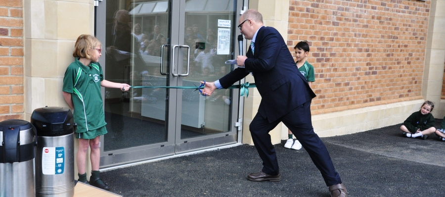 Piers Heyworth cuts the ribbon