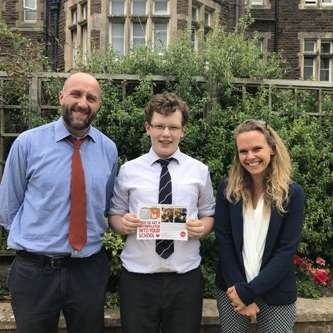 Brave Joshua Sutton-Dodd (centre) with teachers Emma Arrand and Rob Picken.