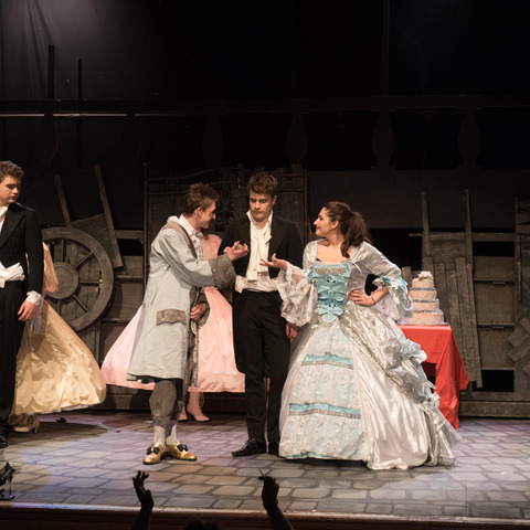 Christian Loizou (centre) played the part of Marius with Matthew Phillips (left) and Jemima Gray as the Thénardiers.